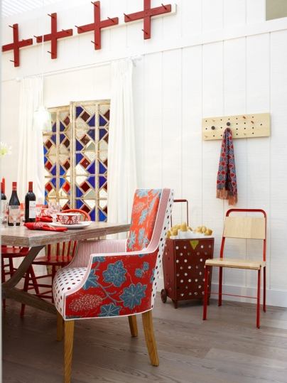 Boho chic dining room with red accents