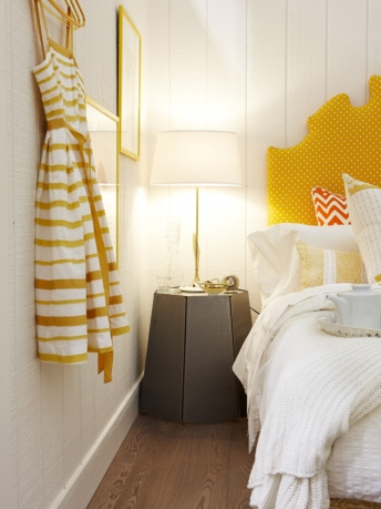 Yellow decor and stripe dress on shiplap wall in colorful modern farmhouse bedroom by Sarah Richardson