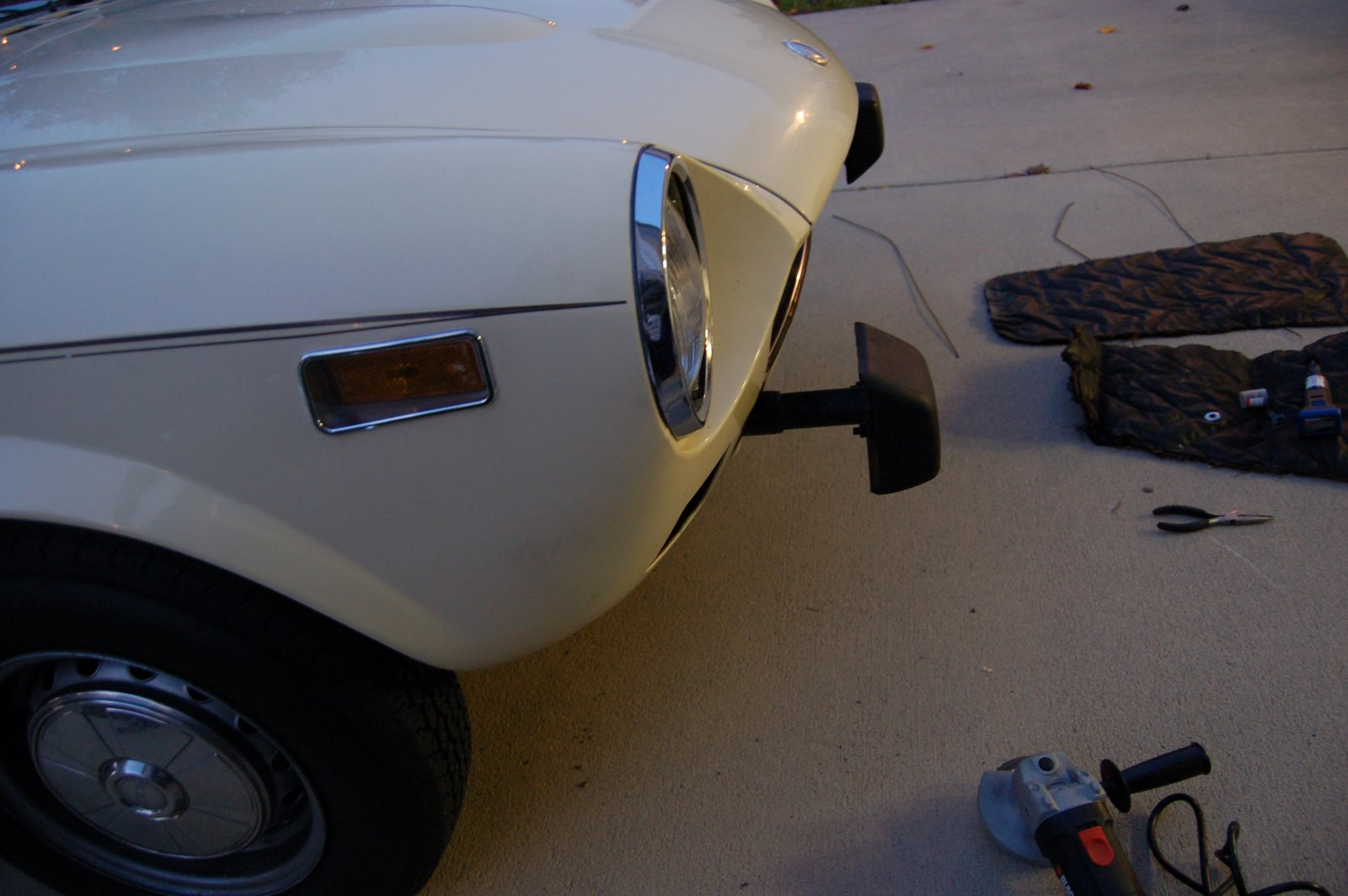 modern motoring handbuilt by robots fiat 124 spider abarth type Black Fiat Spider it caught a flame while i was using the cutting wheel to extend the 10mph bumper shock bracket to ac modate the jeep tj bumper over riders i purchased off