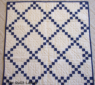 Hand quilted blue and white quilt in squares
