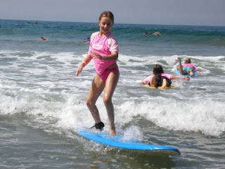 Learn to surf at Aloha Beach Camp summer camp in Malibu, Los Angeles, California