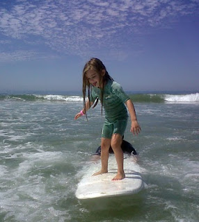 Aloha Beach Camp Keiki Camper Ava B. learns to surf at Zuma Beach in Malibu
