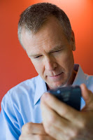 Cell Phone User - Source: blog.usa.gov