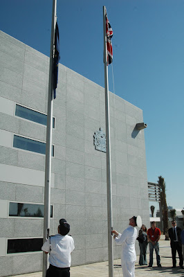 Flags are raised at the British embassy in West Bay