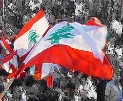 A crowd wave the Lebanese flag: Source FlickrJunkie