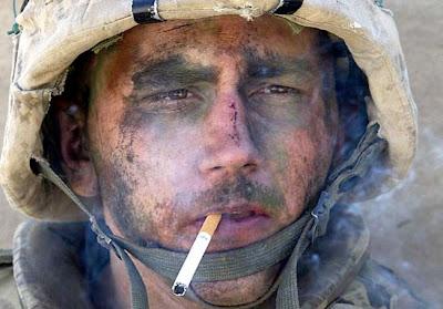 An Iraqi veteran smokes after combat.