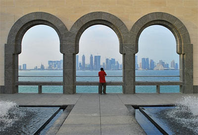 A photographer is framed against the arches of the Islamic museum