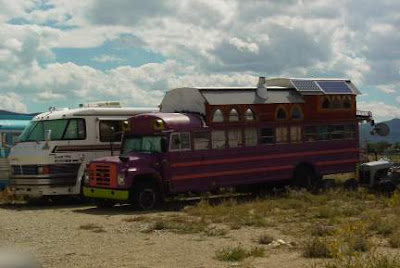 Customized bus in storage yard, Taos, New Mexico