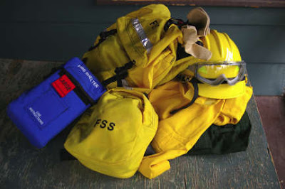 hard hat, protective clothing, and fire pack. photo by Chas S. Clifton