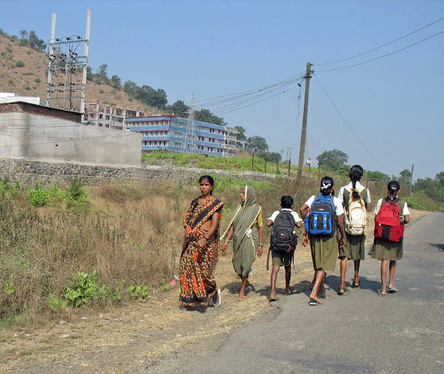 children walking to school in rural india