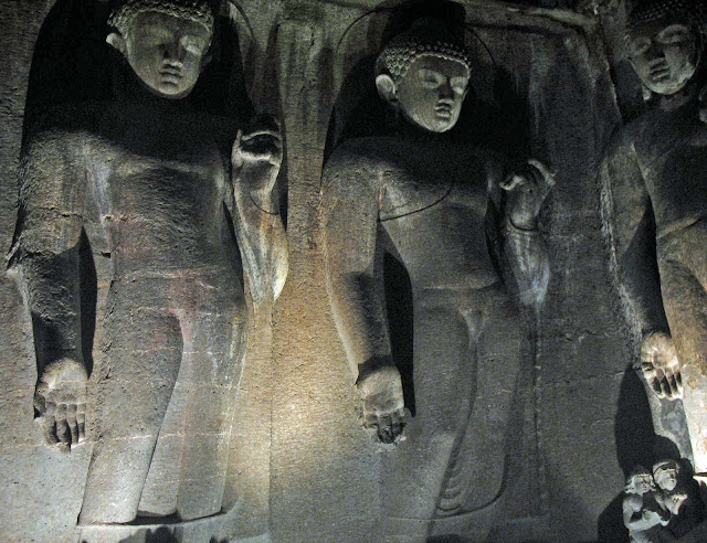 Buddha figures inside cave