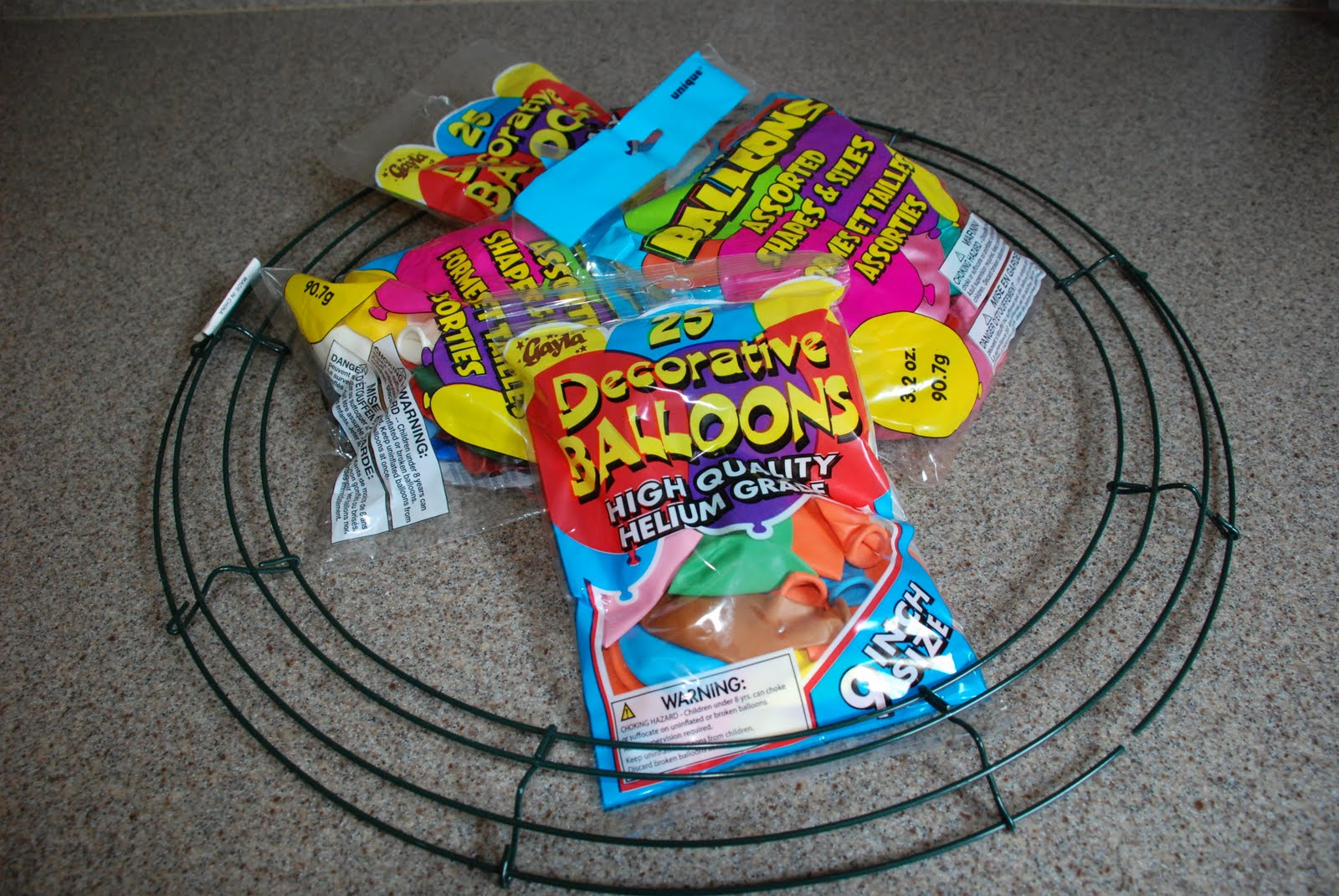 I Started Out With A Wire Wreath Found At Micheals For 299 And About 8 Bags Of Balloons From The Dollar Store