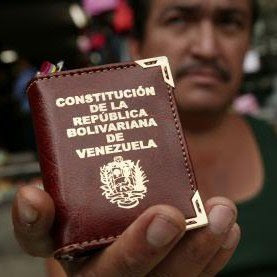 Venezuelan holds up his constitution