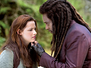 Bella (Kristen Stewart) and Laurent the Vampire (Edi Gathegi) - New Mon Movie