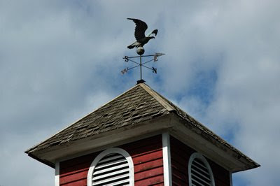 a copper eagle weathervane follows the wind at the Shelburne Museum