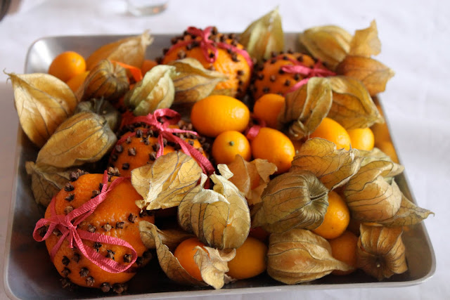 I studded tangerines with cloves and tied ribbon around them, you can do this with any citrus fruit, smells lovely.