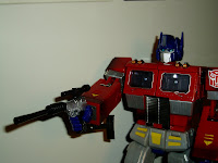 20th Anniversary Prime holding Megatron rifle