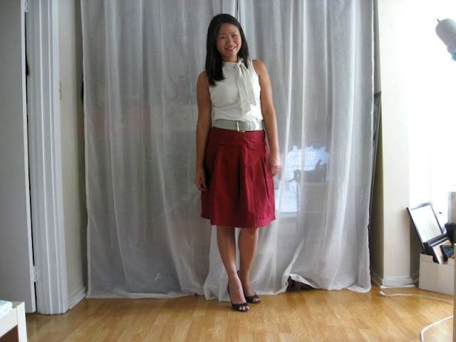 office fashion blogger wearing ann taylor loft tie neck shell wide belt target a-line skirt enzo angiolini peep-toe pumps
