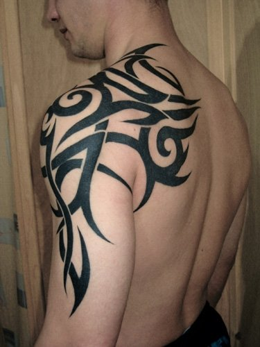 Upper Arm Tattoo For Guys: Genre Of Tattoos: December 2010