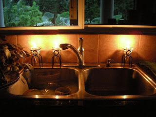 washing dishes by candlelight