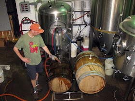 Scott cleaning out barrels before filling them with kvass.