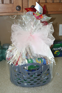 Gift basket with snacks decorated with ribbon