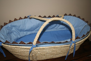 Blue and natural straw Moses basket