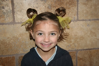 Portrait of young girl modeling Easter Hairstyles: Bunny-Ear Pigtails