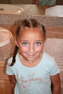"Portrait of girl's hair styled in ""Criss-Cross French Braids"""