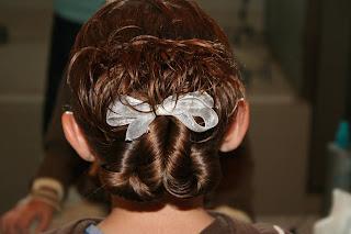"Back view of young girl modeling ""Pretzel-Twist Messy Bun"""