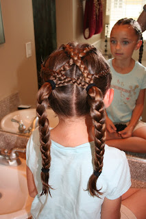 "Back view of girl's hair styled in ""Criss-Cross French Braids"""