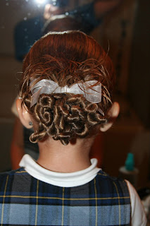 "Back view of young girl modeling ""Ponytail Of Twists"" hairstyle"