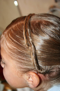"""Side view of young girl's hair being styled into """"Hair Headband"""" hairstyle"""
