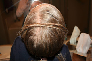 """Top view of young girl's hair being styled into """"Hair Headband"""" hairstyle"""