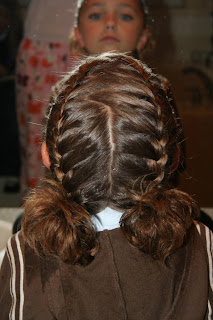 """Back view of young girl modeling """"Double-French Braids w/Messy Flips"""""""