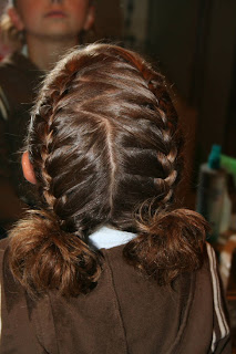 """Back view of young girl's hair styled into """"Double-French Braids w/Messy Flips"""""""