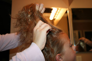 Young girl's 2nd Day Curls from Double-French Braids being styled