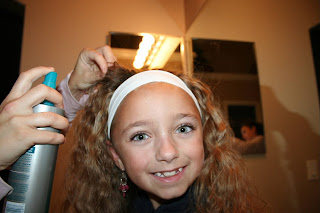 Front view of Young girl's 2nd Day Curls from Double-French Braids being styled