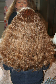 Back view of young girl modeling 2nd Day Curls from Double-French Braids