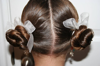 """Back view of young girl modeling """"Basic Twisty Buns"""" hairstyle"""
