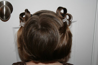 "Back view of a young girl outside modeling ""Heart Pigtail"" hairstyle"