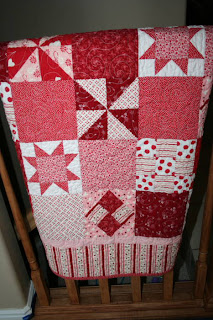 Valentine's Day themed quilt hanging off a chair