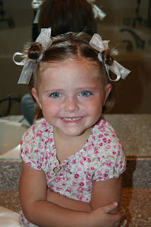 """Portrait of young girl modeling """"twisty buns"""" hairstyle"""