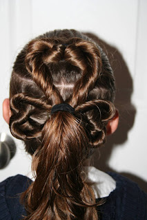 "Back view of young girl modeling ""Best Three-Leaf Clover"" hairstyle"