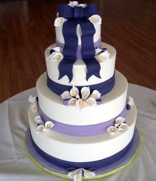 http://2.bp.blogspot.com/_7rGtNIIIs8s/SysYKM5MQxI/AAAAAAAAAW4/yLTgXc4rWfs/s400/Wedding+Cake+round+white+-+Contemporary+Calla+Lilies.jpg