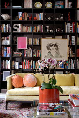 An anomaly: Should you hang your artwork directly on the face of your bookshelves?