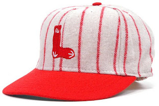 1931 - Little sock logo on a red-pinstriped cap - a one-year experiment. f3d1edd73e90