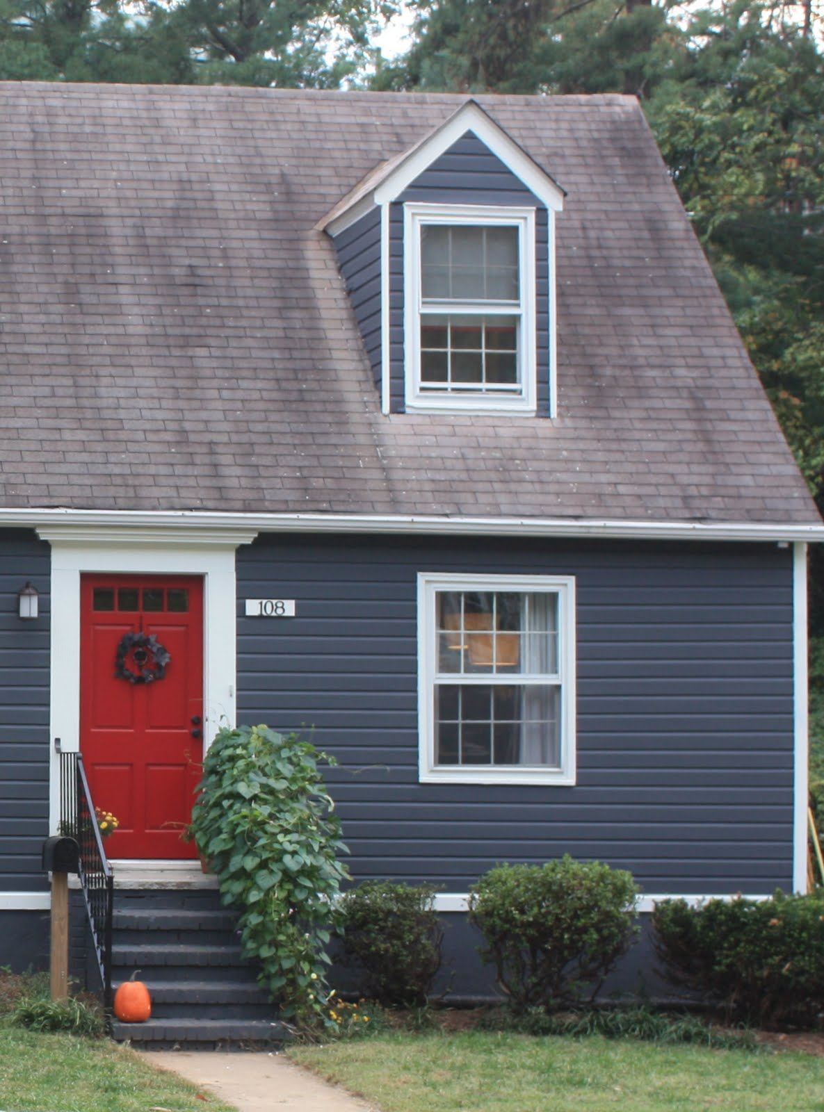 Dried figs and wooden spools blue house red door - White exterior paint color schemes ...