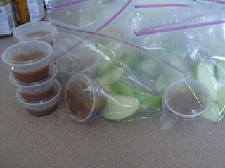 sliced green apples in plastic baggies with small plastic cups with carmel prepped for a make ahead lunch plan.