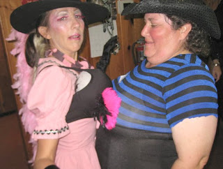Two women dressed up in costumes dancing (Halloween photos courtesy of  Redwood Rainbow Square Dance Club)
